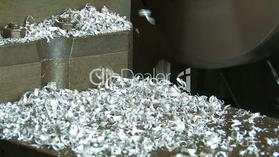 Aluminum shavings. Manufacturing of details on a lathe.