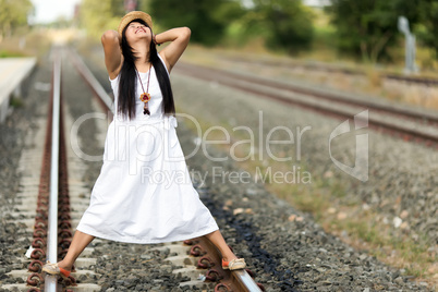 young woman standing on a railway track
