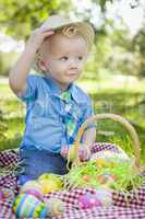 Cute Little Boy Outside Holding Easter Eggs Tips His Hat
