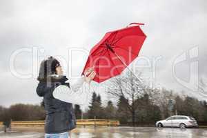 woman is running her umbrella flying away