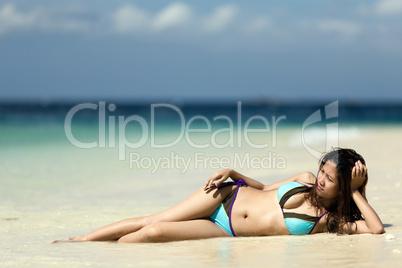 filipina woman lying on sand