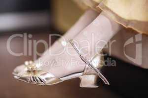 girl wearing elegant gold sandals