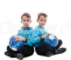 Image of amusing twin brothers posing with balls