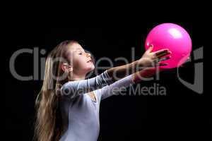 Emotional rhythmic gymnast dancing with ball