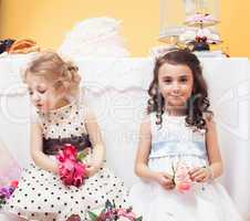 Image of beautiful girls dressed in lush dresses
