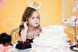 Fascinating little lady posing with tasty treats