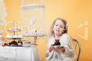 Charming little lady posing with cake