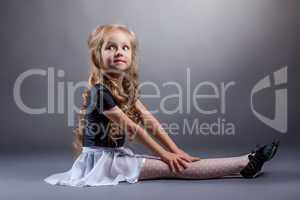 Adorable dancer posing in costume for performances