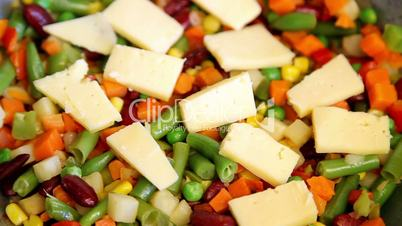 cheese appearing on vegetable mix