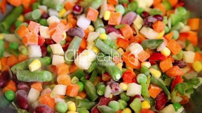 Frozen vegetable mix on frying pan