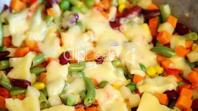 cooking vegetable mix with cheese