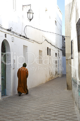 moroccan walking through narrow alley