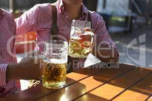 two men sitting in a beer garden