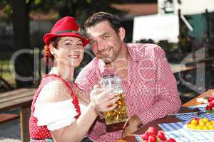 couple in traditional costume in a beer garden