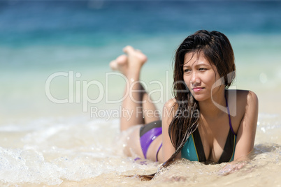filipina woman lying on sand