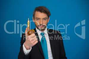 businessman with e-cigarette wearing suit and tie on blue