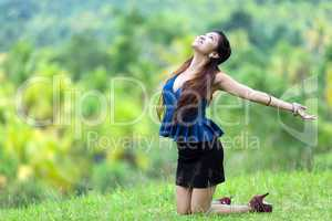 beautiful filipina woman rejoicing in nature