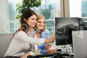 businesswomen looking at computer monitor