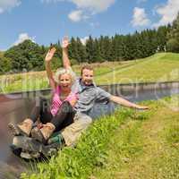 couple enjoying summer sledge
