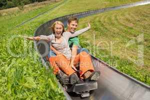 couple enjoying alpine coaster luge