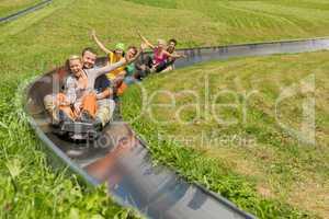 happy couples enjoying summer sledge