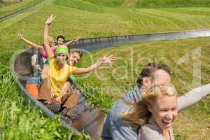 excited couples enjoying alpine coaster luge