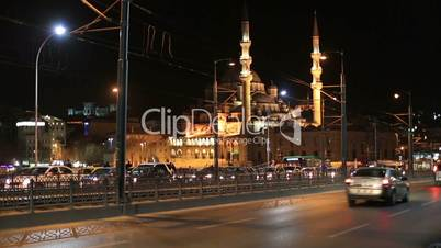 time lapse traffic on the Galata Bridge with Mosque, tracking shot