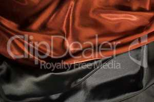 Shiny black and red satin fabric