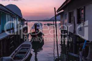 dusk in thai fishing village