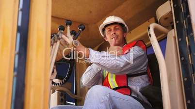 industrial male grader thumbs up