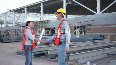Industrial Male Greets Forewoman