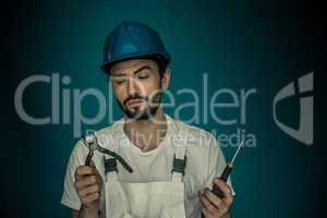 Workman standing eyeing his tools