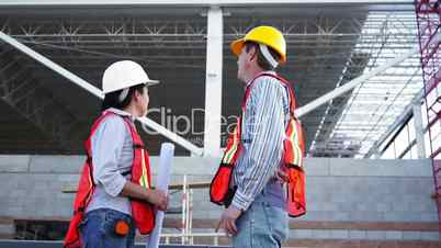 industrial male enters talks low angle