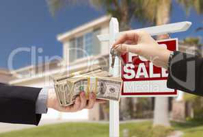 Agent Handing Over Keys, Buyer Handing Over Cash for House