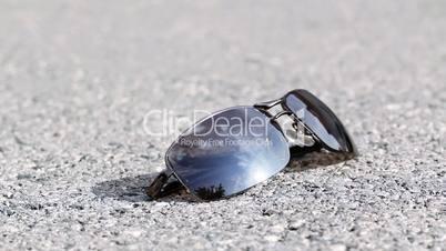 Man steps on sunglasses