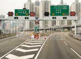 Hong Kong Interstate. Signs entering the city