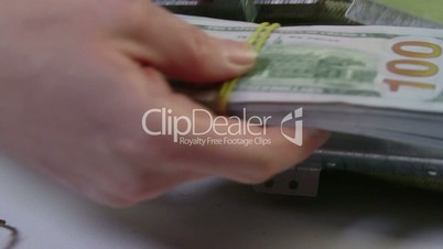 Dollars packs folded in cash collection bag and sealed
