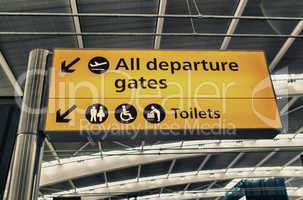 All departure gates and Toilets sign in the airport
