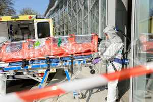 Biohazard medical team member with stretcher