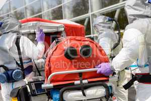 Biohazard team pushing stretcher towards chamber