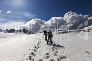 Two hikers on snowy plateau