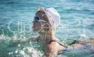 beautiful blonde woman swimming in the sea
