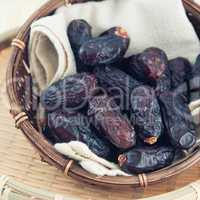 dates fruit or kurma in bamboo basket.