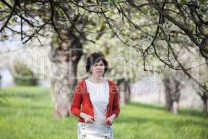 Woman is recovering under blooming cherry tree old