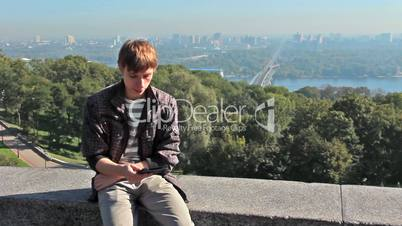 Young Man Reading On Electronic Book At Kiev