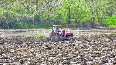 tractor is plotting agriculture field for seeding