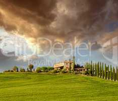 Countryside of Tuscany in spring season. Green fields and dramat