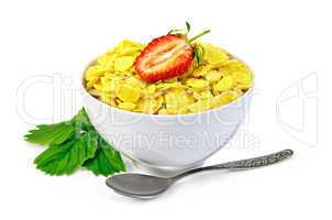 Cornflakes in a white bowl with strawberries