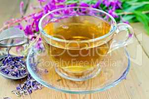 Herbal tea from fireweed in cup with strainer