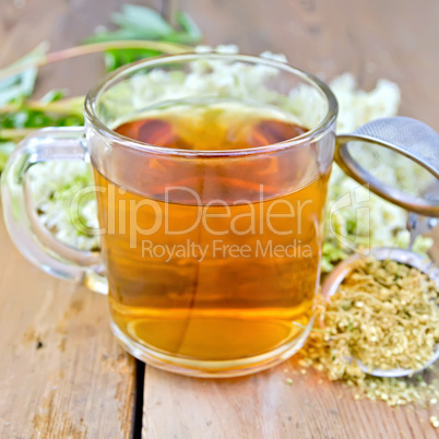 Herbal tea from meadowsweet dry in mug with strainer